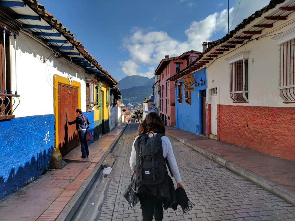 a tourist girl walking on a paved road